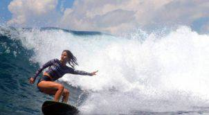 janine-riding-waves-on-bali