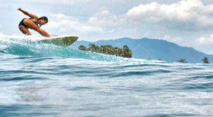 girl-surfing-bali-waves